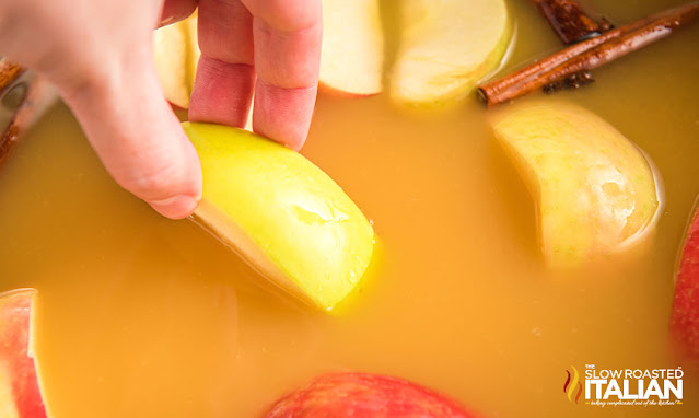 adding apple to the pot
