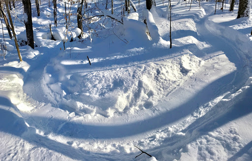 More corner and berm work. Snow depth building in the woods!