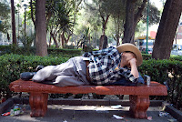 Sleeping on a park bench in Mexico City. You can almost see the radio that was playing all the time.