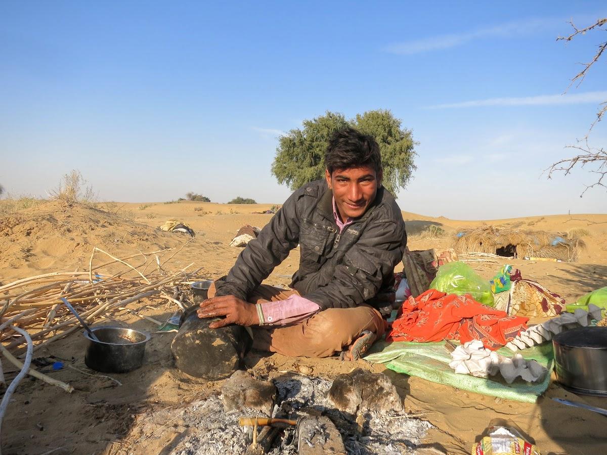 India. Rajasthan Thar Desert Camel Trek. Madan showing us desert cleaning