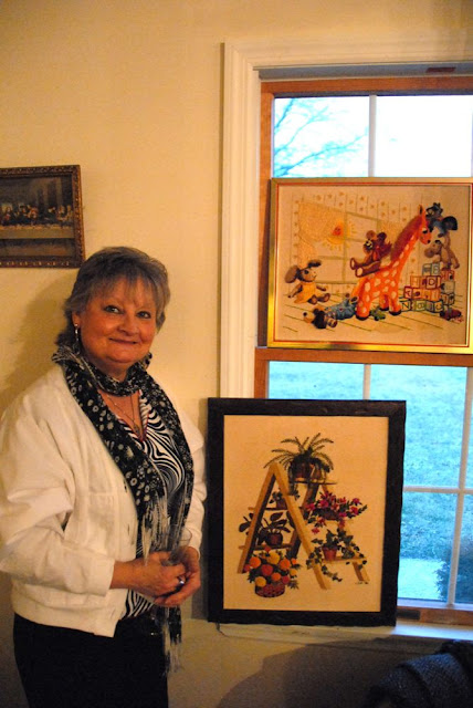 Linda with some of the art on display.