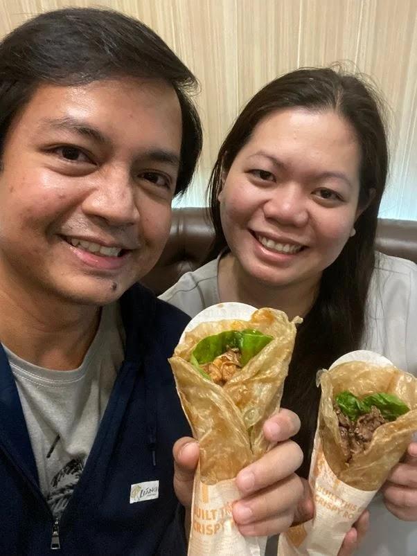 Enjoying our Liang Crispy Rolls