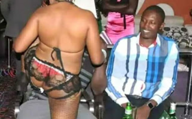 Ugandan Lawmaker And His Friends Spotted Watching Nearly Neykked Woman Dance At A Bar (Photos)
