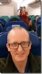 On airplane to Hong Kong