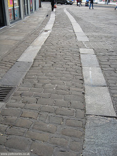 May 2013, cart tracks and setts, King's Square, looking towards Colliergate