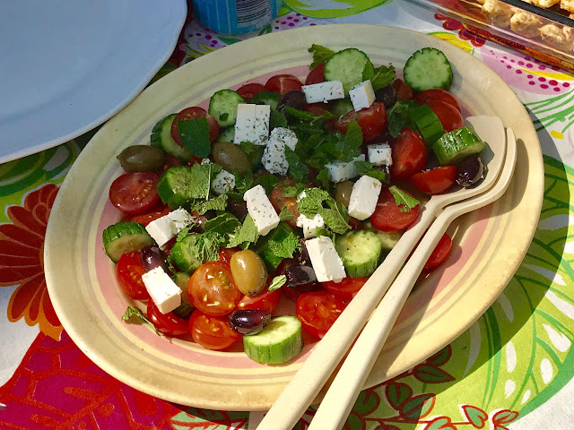 Marinated Greek tomato salad with olives and mint