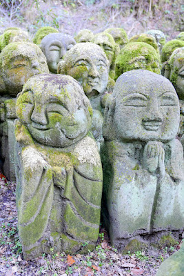 Otagi Nenbutsuji Temple features 1200 stone sculptures of rakan, the Buddha's disciples, all with different facial expressions and poses. This one on the left has kind eyes and smile