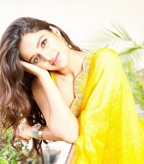 Nidhhi Agerwal Flaunts The sunshine Yellow Organza Saree For Her Upcoming Movie Promotion.