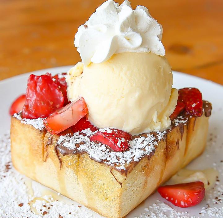 photo of Honey Toast with Nutella, vanilla ice cream and strawberries