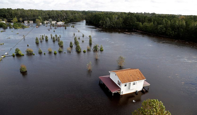 A house is surrounded by floodwaters from Hurricane Florence in Lumberton, N.C., Monday, 17 September 2018. Photo: Gerald Herbert / AP Photo