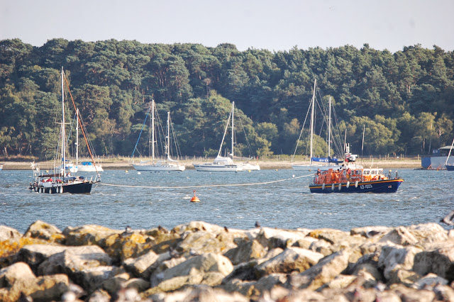 Poole ALB towing the yacht in an astern tow, with fenders at the ready to bring the yacht alongside. 22 August 2013 Photo credit: RNLI/Dave Riley