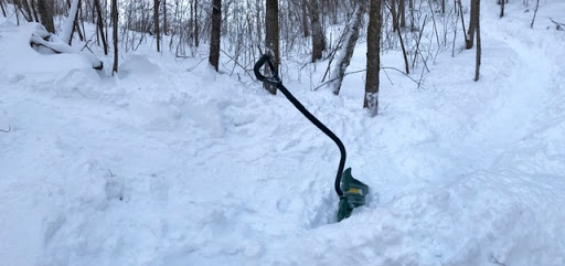 Shoveling out a drifted section on the fat bike loop