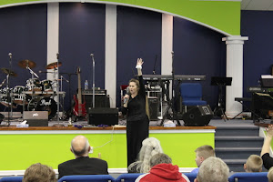 Susan ministering to the church.