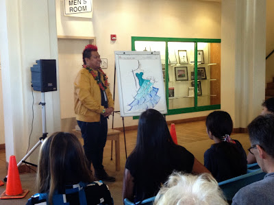 Picture of Kini Zamora speaking at event Jan. 31, 2015