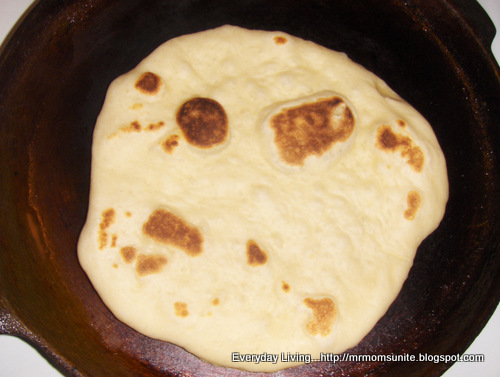 photo of Naan bread cooking