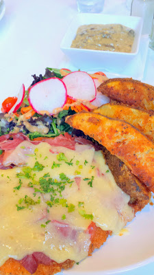 Pacific Pie NW 23rd, Chicken Schnitzel that is skillet fried, seasoned and crumbed chicken breast served with your choice of potato and with a small green salad. I upped it by adding ham and melted Tillamook Cheddar