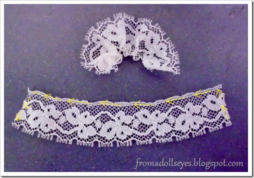 Gathering lace for a doll dress.