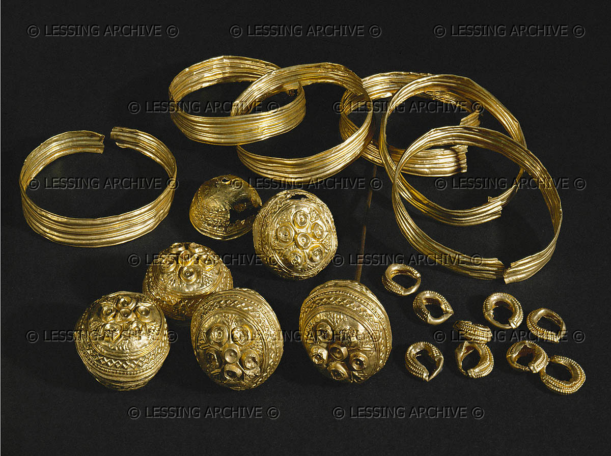 Gold bracelets, hollow pin-heads, and earrings from a tomb at Schoeckingen, Germany Diameters: 5.4 - 6.2 cm; 1.9 - 3 cm; 1.2 - 1.3 cm