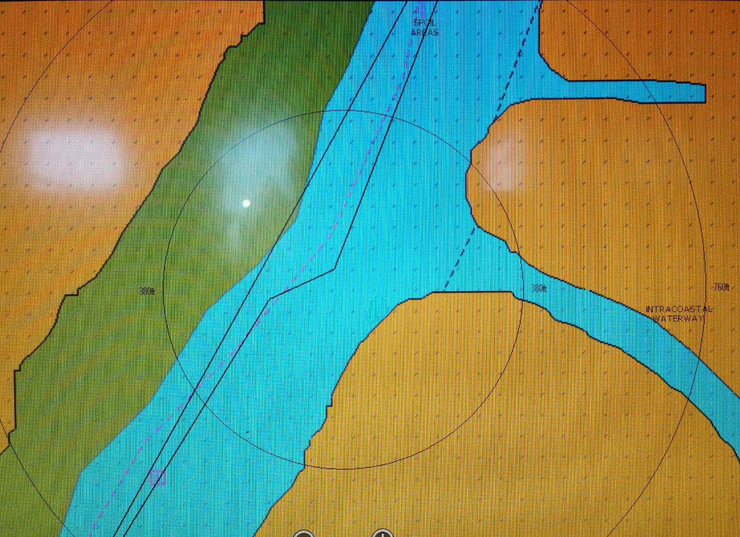 The dotted magenta line indicates the ICW centerline, but its not always  accurate. The blue indicates sufficient water and the green indicates a  shoal.