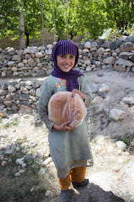 "Local girl carrying bread called ""Pitti"""