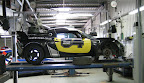Lotus Exige up on the ramp in the garage. (Keith Saunders)