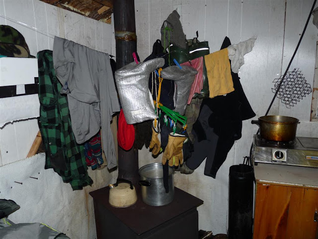 Drying out our clothes after a wet day in the bush.