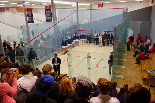 Dent Wilkens from US Squash introducing the Trinity/Harvard teams before the finals.