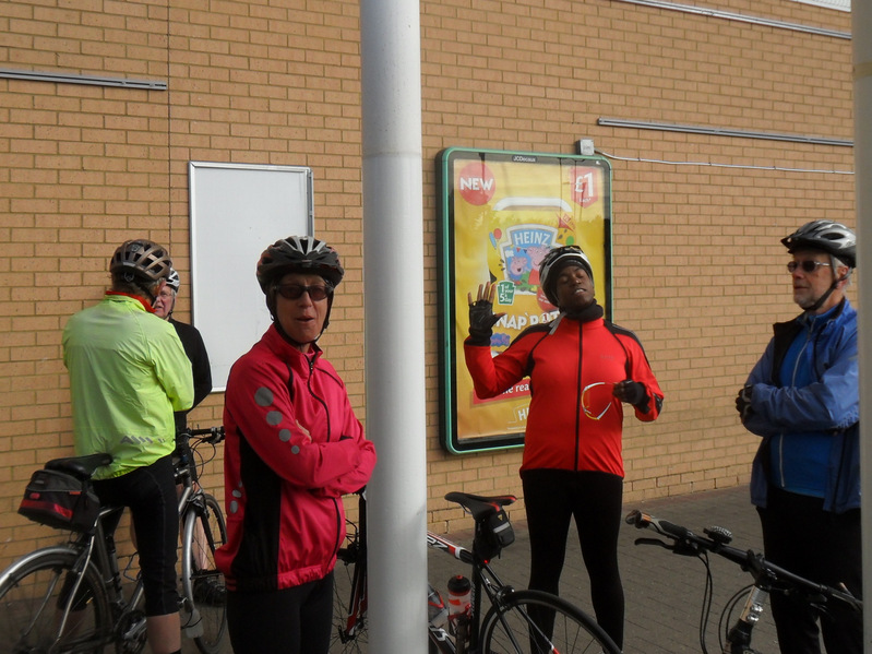 Cyclists standing around