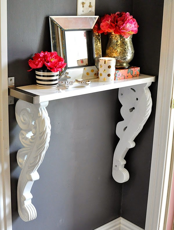 Monica used thrifted corbels and a ready made shelf to create a custom, high-end looking foyer table. Simple, stunning and easy for any DIY maven.