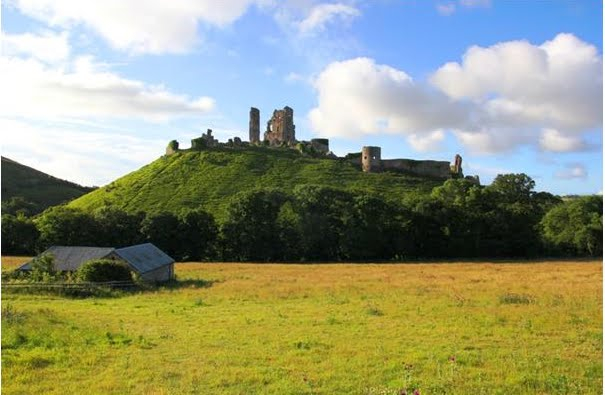 The ruins of Corfe Castle on its pimple, commanding the surrounding countryside.