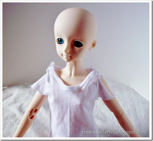 A cute t-shirt for a ball jointed doll.