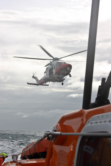 9 October 2011. Poole lifeboat and Coastguard helicopter 106 on exercise in Poole Bay. Photo: Poole RNLI/Ade