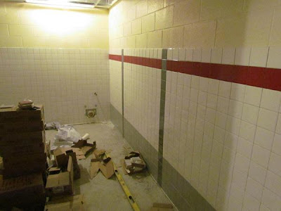 Bathroom tile installation has begun