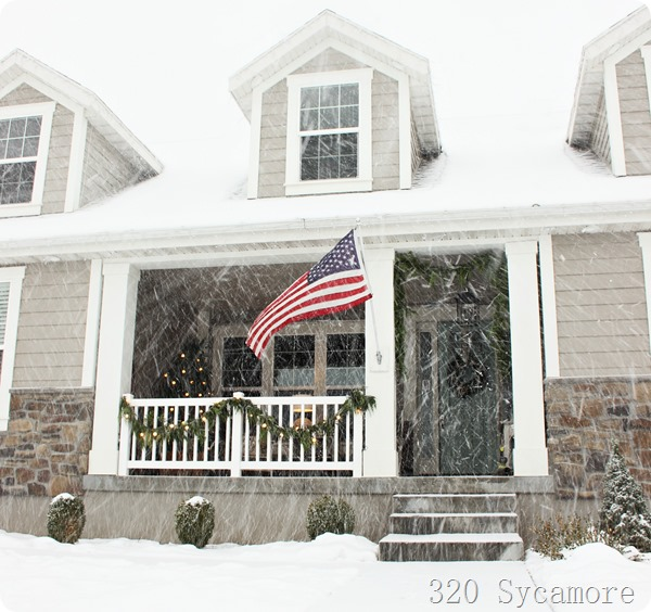 house and flag in snow
