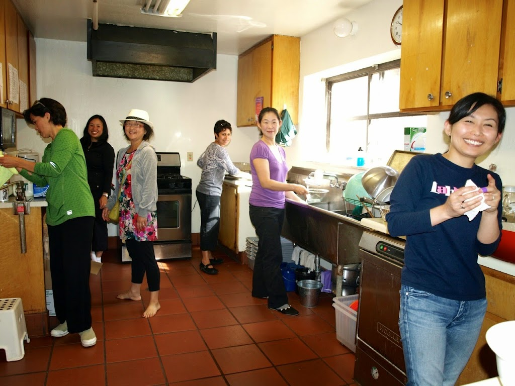 Waffle breakfast volunteers in kitchen