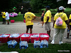 Volunteers handing out water at the finish line.