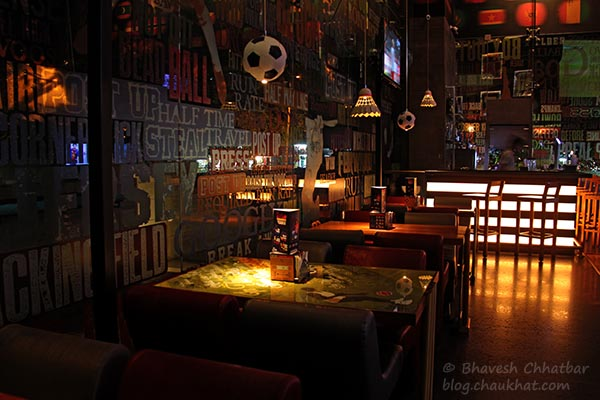 Seating arrangement at Toss Sports Lounge Koregaon Park
