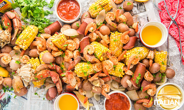 Low country boil spread out on newspaper