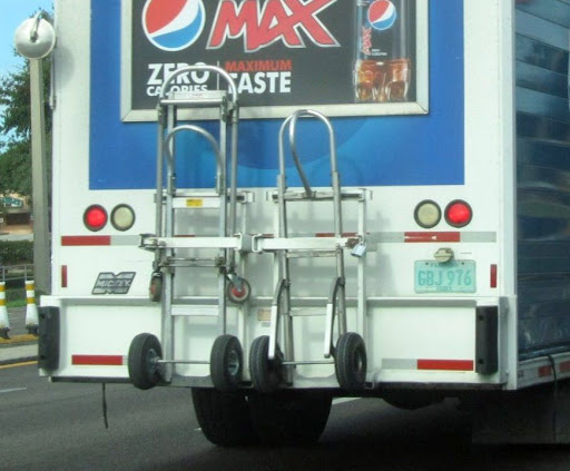 Magliner hand trucks padlocked to pepsi cola beverage truck