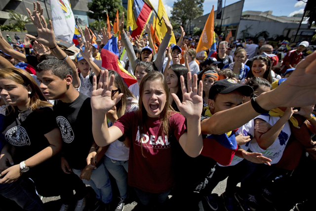 Students chant: 'Elections now!' during a protest in Caracas, Venezuela, on Monday, 23 January 2017. Thousands of opponents of President Nicolas Maduro took part in the march. Photo: Fernando Llano / AP