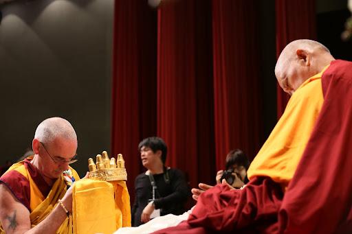 Ven. Roger Kunsang offering mandala during long life puja, Taiwan, February, 2013.