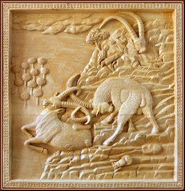 Cabras monteses. Talla en madera