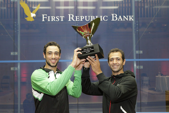 Egypt, represented by Ramy Ashour and Amr Shabana, proudly lift the Sharif Khan Cup after beating England in the Squash Showdown at Boston Symphony 2012