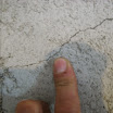 A hairline concrete foundation crack.  This crack can be fixed using A-Tech 212 LV epoxy resin material.
