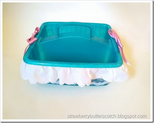 The finished and nicely decorated plastic caddy, now a pretty headband holder.