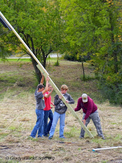 Cris Patrick Schwanebeck (in red shirt) and members of Knoxville Boy Scout Troop 377 erected four bat houses at Marion County Park. Cris Patrick is working on earning his Eagle Scout Award.
