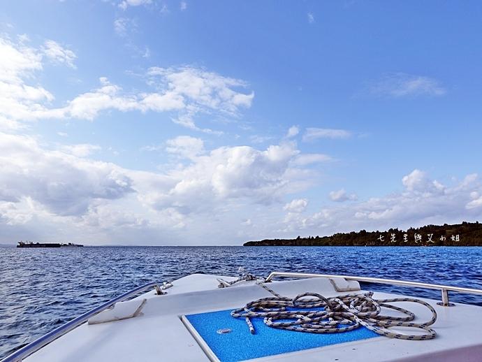 7 沖繩自由行 水上活動 香蕉船 Marine Support TIDE 殘波 藍洞海洋觀光 藍洞浮潛&珊瑚礁 餵食熱帶魚浮潛
