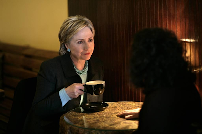 photo of Hillary Clinton with cup of coffer during the 2008 Presidential Campaign, New Hampshire by Brooks Kraft