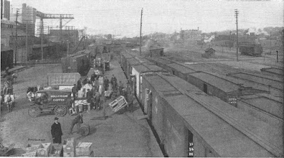 "Chicago & Northwestern Railway Yard, Blount St in the foreground, looking east.  Blount Street power plant is on the left. Madison Gas & Electric Co Blount Street Station, from Blount St. - From ""Madison - The Four Lake City"", 1914"
