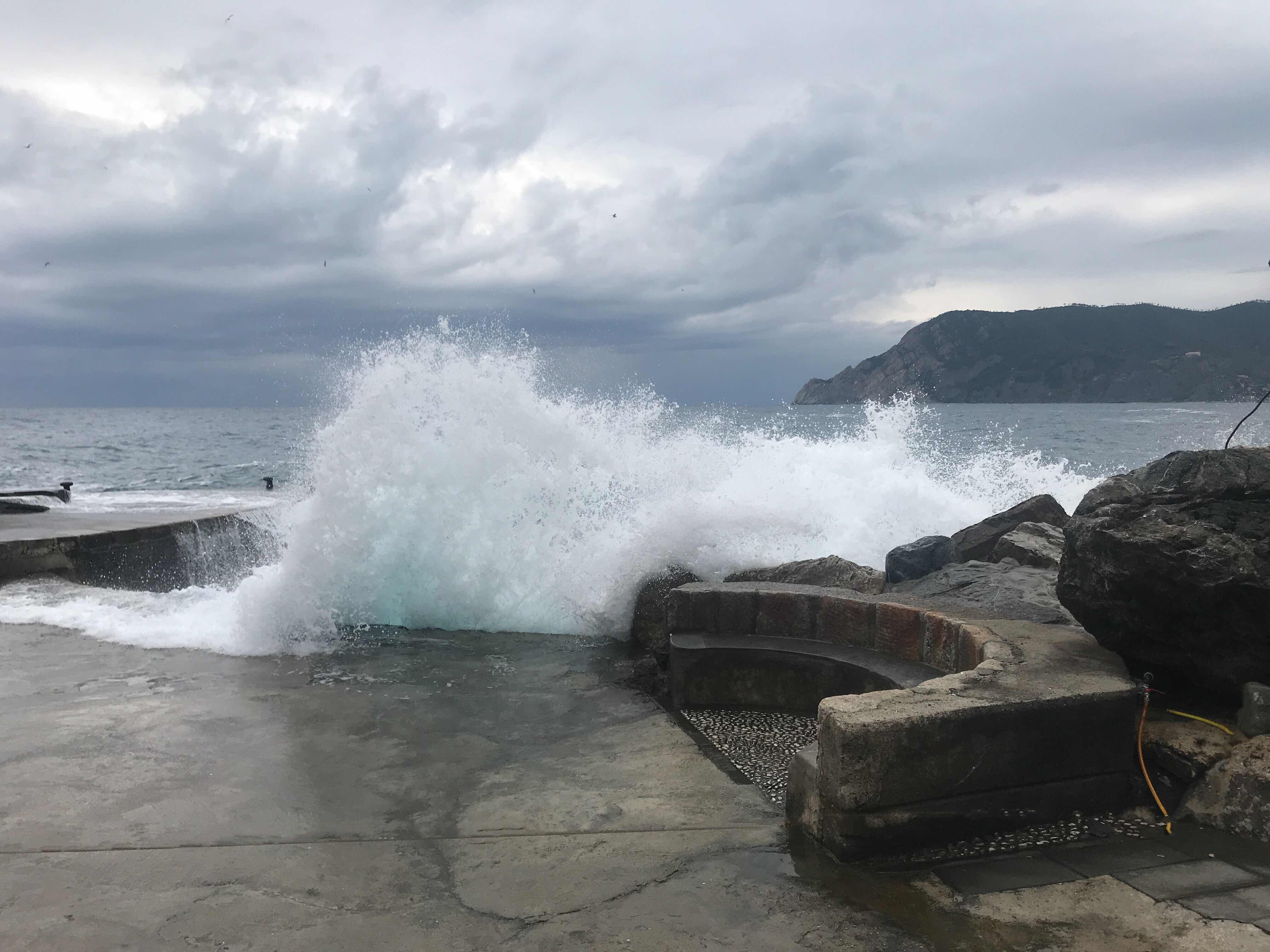 wave striking Vernazza outer harbor